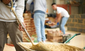 Cropped shot of three male college students in bricklaying workshop
