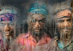 Gravel Workmen of Chittagong, Bangladesh, by Faisal Azim Gravel workmen look through a glass window at a gravel-crushing yard in Chittagong. Full of dust and sand, it is an extremely unhealthy environment for working, but still hundreds of people work here for their livelihoods.