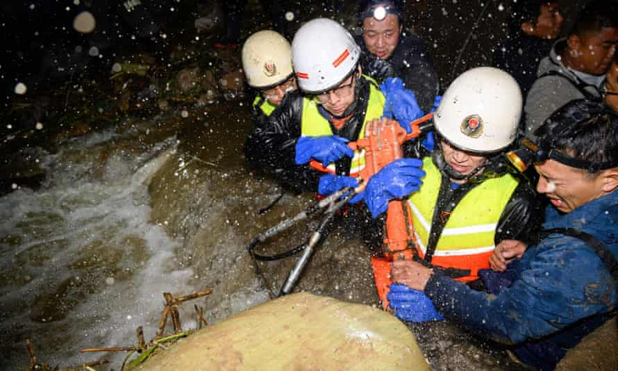 Rescuers drawing water at a flooded area in China's northern Shanxi province
