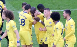 N'golo Kante is mobbed by team-mates.