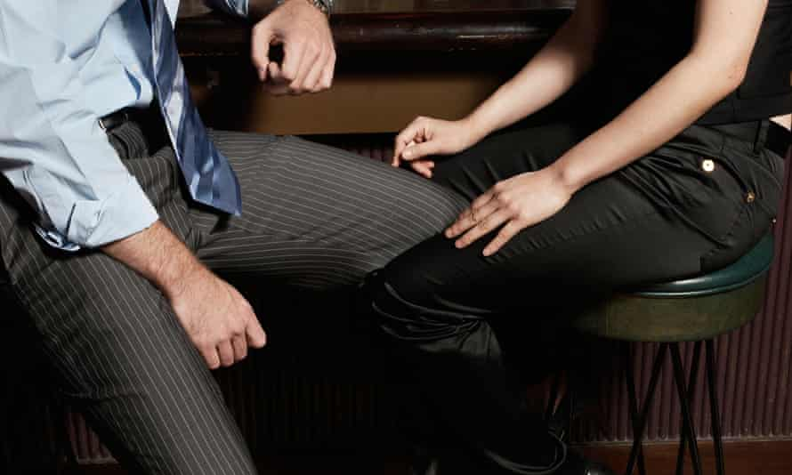 A couple flirting in a bar