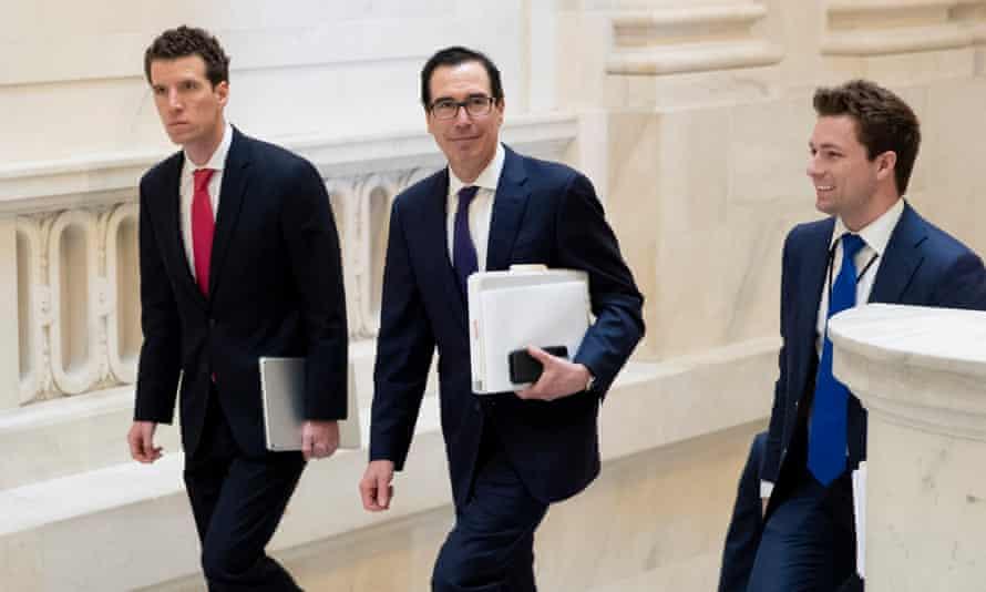 The US treasury secretary, Steven Mnuchin, centre, walks to a Republican policy luncheon, on Capitol Hill in Washington on Wednesday.