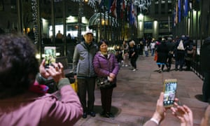 Tourists from China pose for photographs at the Rockefeller Center in New York.
