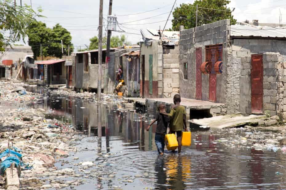 Children are seen in the shantytown of Cité Soleil.