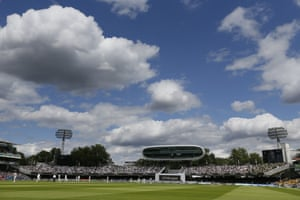 Fluffy clouds hang in the sky as England take to the field to bat.