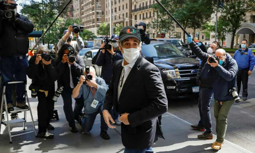 Michael Cohen arrives at home after being released from federal prison due to the coronavirus pandemic in New York, New York, on 21 May.