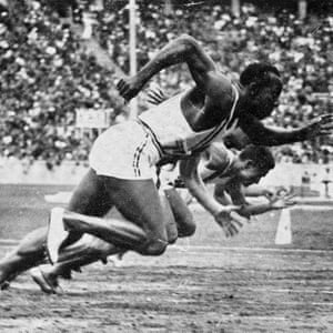 Jesse Owens at the start of the 100 metres. He would become the star of the games, winning four gold medals. Photograph: Roger-Viollet/REX/Shutterstock