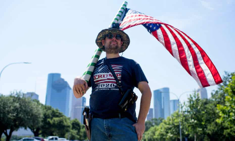 Kenny Wolfam open carries a pistol and wears a 'Trump 2020' T-shirt while counter-protesting a 'Moms Demand Action' protest in response to a new Texas gun law at Buffalo Bayou Park in Houston, Texas, last month.