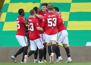 Maguire celebrates after his goal.