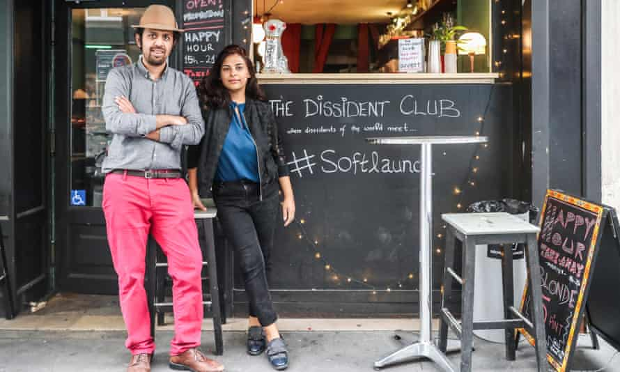 Taha Siddiqui and his wife, Sara Farid, in front of their cafe The Dissident Club in Paris last summer.