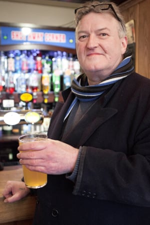 Landlord Micky Taft drinks cider in his pub, The Bell, in Shepton Mallet.