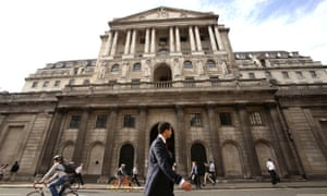 Man walks past Bank of England