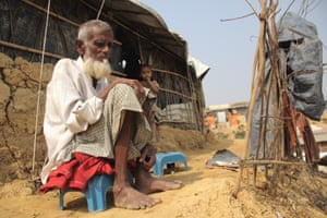Nagumia, an 82-year-old Rohingya refugee, and his grandchild in the Moinerghona camp.