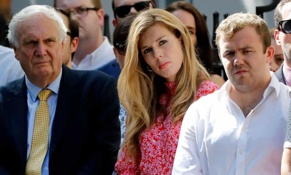 Carrie Symonds (c), girlfriend of Boris Johnson, watches as he gives a speech outside No 10 in July.