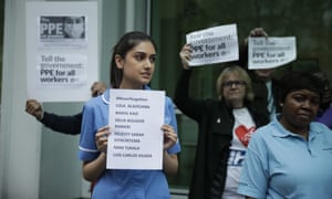 NHS workers stage a protest calling for PPE outside University College hospital in London on Tuesday, Workers' Memorial Day.