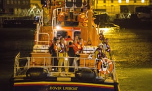 Students return to Dover on a lifeboat after being rescued from a beach
