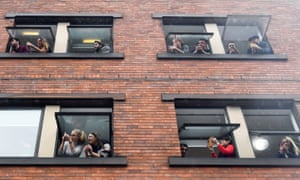 People lean out of windows to catch a glimpse of Greta Thunberg