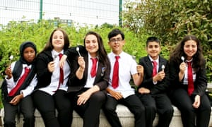 Pupils from the Co-operative Academy of Leeds, with spoons given by the school to raise awareness that most forced marriages take place during the summer holidays.