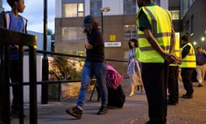 Residents leaving flats in London