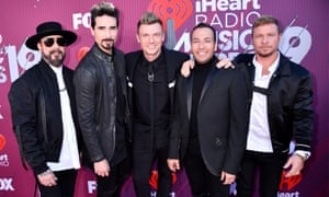 (L-R) AJ McLean, Kevin Richardson, Nick Carter, Howie Dorough, and Brian Littrell of Backstreet Boys attend the 2019 iHeartRadio Music Awards, in pre-coronavirus times.