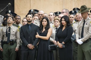 Los Angeles, US Matthew Solano, second left, waits for his father Los Angeles County Deputy Joseph Solano's casket to be carried into the Cathedral of Our Lady of the Angels. Solano was shot in an off-duty attack and died at a hospital two days later