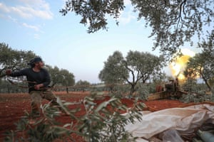 A Syrian rebel fighter fires a cannon during clashes with government forces in the last major rebel bastion of Idlib.
