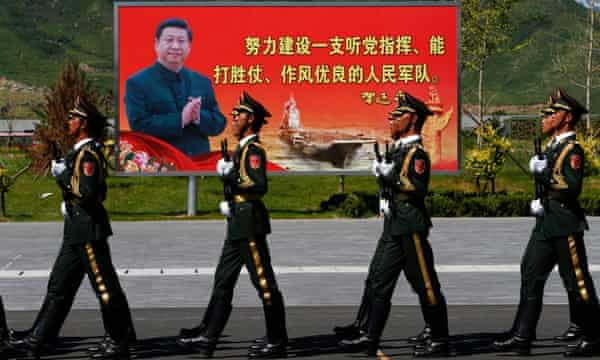 Soldiers of the people's liberation army march past an image of the Chinese president, Xi Jinping, during rehearsals for the military parade on 3 September.