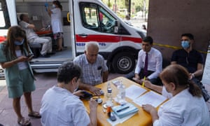 Iranians preparing to get vaccinated at a mobile centre in Yerevan, Armenia today.