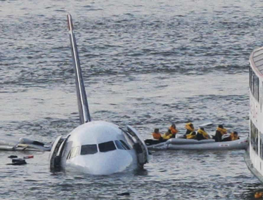 Passengers in an inflatable raft move away from a plane that went down in the Hudson river in 2009.