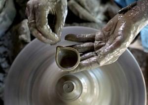 Artist Sibaprasad Pandit makes an earthern lamp at a traditional workshop ahead of Diwali festival. Kolkata, India