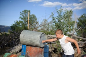 Vinny punches dustbins behind his aunt's home in northern New Mexico