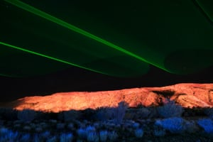 The lasers cast vast figure-of-eight patterns in the sky.