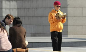 Xiao Jianhua, a Chinese-born Canadian billionaire, reads a book outside the International Finance Centre in Hong Kong. Mystery now surrounds his exact whereabouts.
