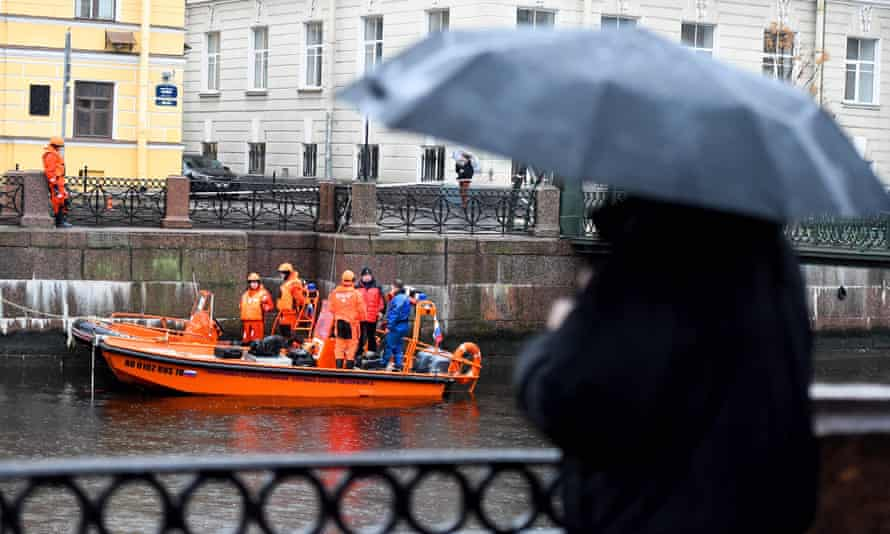 Russian police investigators as they conduct searches on the Moika in Saint Petersburg on Sunday.