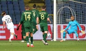 Bulgaria's Bozhidar Kraev slots the ball past Ireland goalkeeper Darren Randolph to open the scoring.