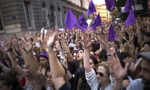 Demonstrators outside the justice ministry in Madrid protesting after five men were sentenced for gang raping a woman at Pamplona's bull-running festival.