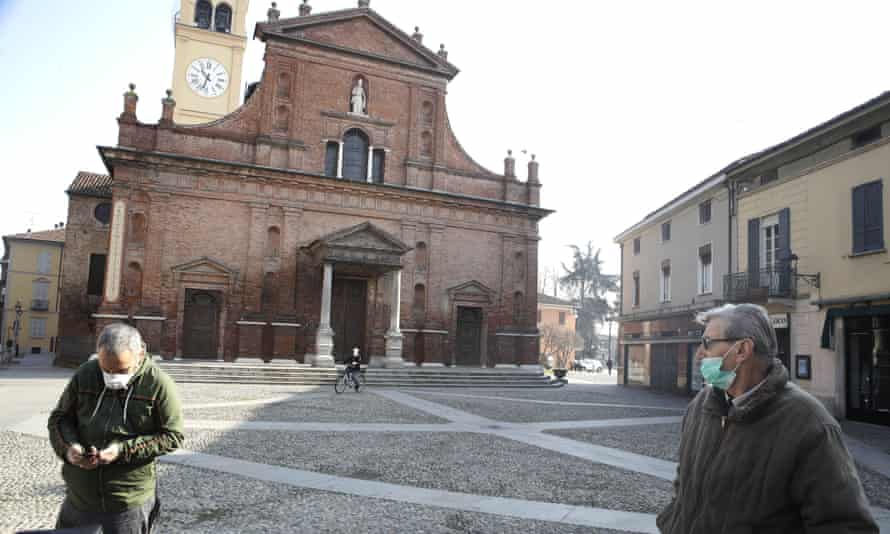 People wearing face masks in Codogno, northern Italy, due to concerns over coronavirus infection.