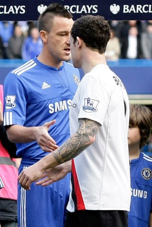 Manchester City's Wayne Bridge avoids shaking hands with Chelsea´s captain and his former teammate John Terry .