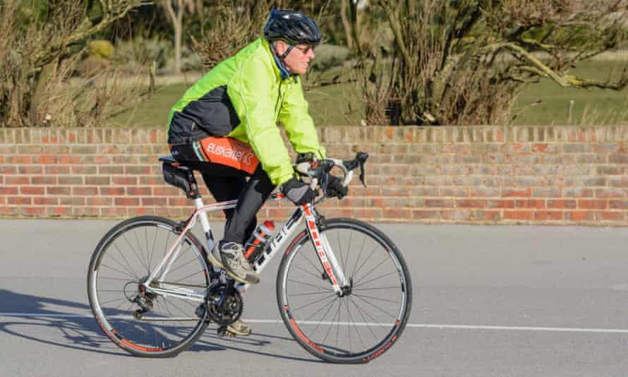 A middle-aged man cycles.