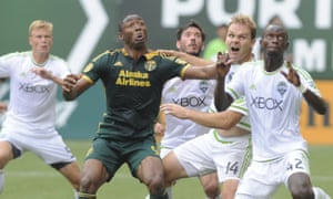 Portland Timbers' Fanendo Adi battles against Seattle Sounders' Michael Azira and Chad Marshall on Sunday.