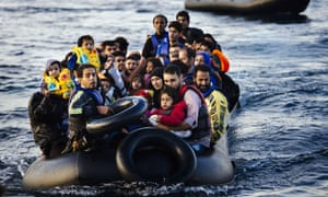 Refugees arrive on a dinghy on the Greek island of Lesbos, after crossing the Aegean sea from Turkey.