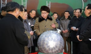 Kim Jong-un talking with North Korean nuclear scientists and technicians.