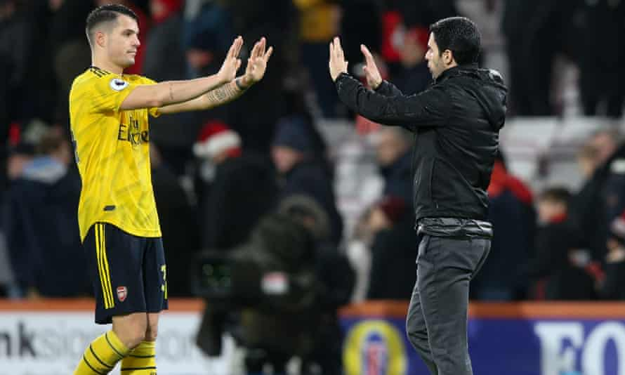 Mikel Arteta (right) and Granit Xhaka after the 1-1 draw at Bournemouth, Arteta's first game in charge of Arsenal.