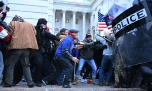 Trump supporters clash with police and security forces as they storm the US Capitol in Washington. Mike Pence and members of Congress were evacuated for their own safety.