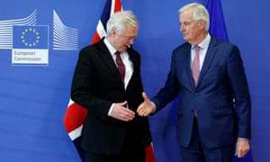 David Davis and Michel Barnier shake hands before Monday's meeting in Brussels.