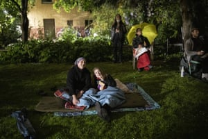 Residents watch a projected movie