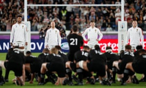 Owen Farrell and the England team look on as the All Blacks perform the Haka.