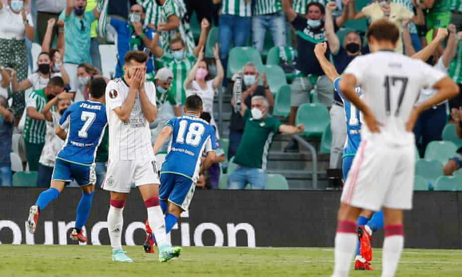 Celtic players react after Juanmi's shot goes in off the post for Real Betis' fourth goal in Seville.