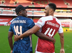 Arsenal's Pierre-Emerick Aubameyang celebrates his new contract with his father Pierre