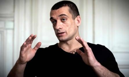 Russian artist Petr Pavlensky speaks during a press interview